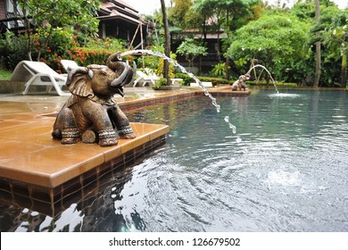 Luxury Outdoor Swimming Pool and an Elephant Water Feature at a Thai Spa Resort
