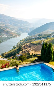 Luxury pool with a view of Douro Valley with the river and the vineyards, Portugal