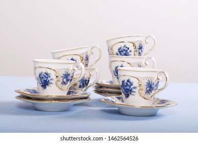 Luxury porcelain tea set with tea pot and cups and saucers.  Elegant and classic design with embossed roses hand painted with cobalt blue and gold.