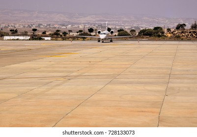 luxury private jet on tarmac of airport