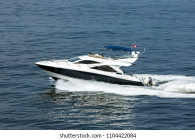 A luxury private motor yacht under way on the sea.