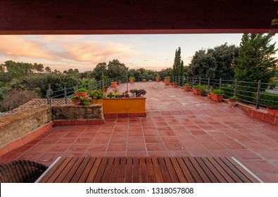 Luxury private villa terrace with red tile and  with a beautiful view of the garden.