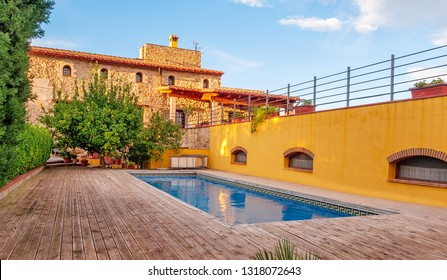 Luxury private villa terrace with swimming pool and beautiful garden views.  Mediterranean country house style. Spain.