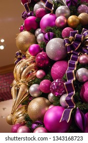 Luxury purple, white and gold decoration of a Christmas tree, close up