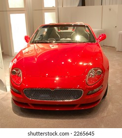 Luxury red car in dealer showroom