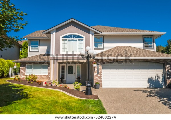 Luxury Residential House Concrete Driveway Grass Stock Photo