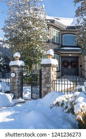 Luxury residential house entrance decorated for Christmass holiday. Family house in snow on winter season