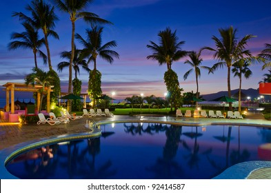 luxury resort with beautiful pool and fantastic ocean view at night