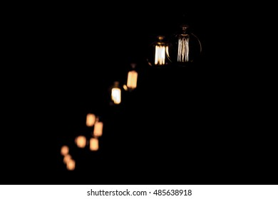 Luxury retro light bulb decor on a black background