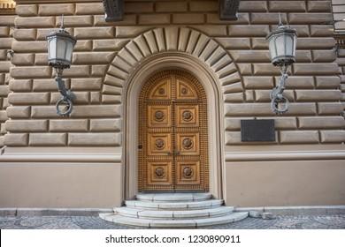 luxury retro wooden doors in brick wall
