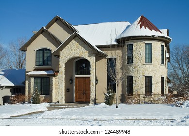 Luxury Romanesque Revival Style Home after a snowstorm.