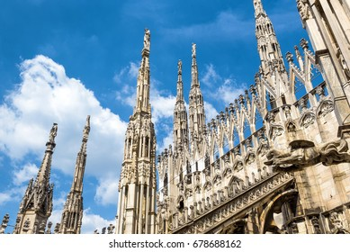 Luxury roof of the Milan Cathedral (Duomo di Milano) in Milan, Italy. Architectural detail on the sky background. Milan Duomo is the largest church in Italy and the main travel attraction of Milan.