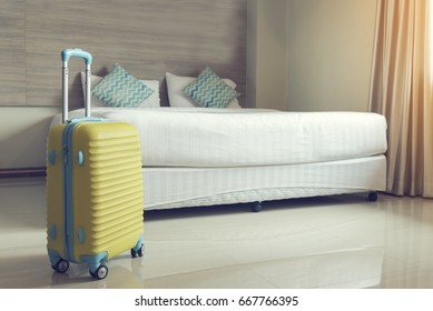 Luxury Room with yellow luggage suitcase on Travel Concept. Special Room with luggage bag and bed in luxury hotel. Honey moon trip.