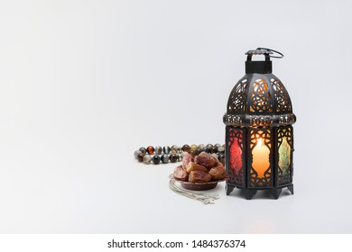 Luxury rosary beads with dates fruit and traditional lantern.
