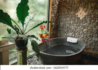 Luxury round  bath outdoor in garden, bali style spa center. Round outdoor bathroom with flower in luxury chic and spa hotel in Bali in Ubud