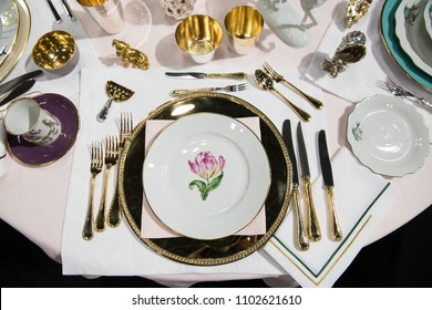 Luxury royal dining set with mani forks and knives on the event in the restaurant