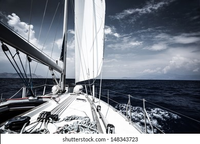 Luxury sail boat in the sea at evening, extreme water sport, yacht in action, summer transport, trip in the ocean, active holidays concept