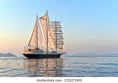 Luxury sailing yacht at sunset in the sea
