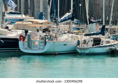 Luxury sailing yachts in the marina, marine recreation on a yacht, high contrast, clear sea