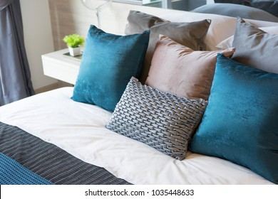 luxury set of blue and gray pillows on bed