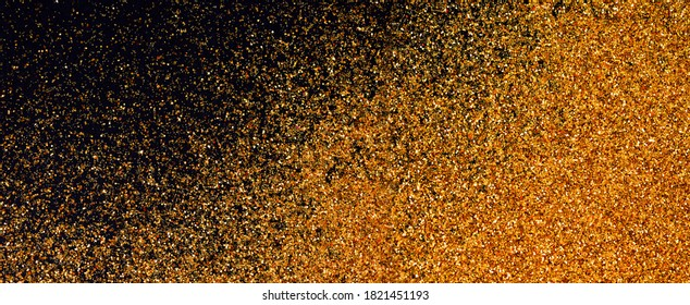 Luxury shiny glitter texture background gold and black. Golden glow surface gradient backdrop. Color glistering dust.