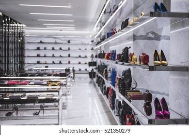 Luxury shoes and handbags in a fancy shop