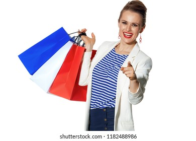 Luxury Shopping. The French way. smiling modern fashion-monger in white jacket isolated on white background with shopping bags painted in the color of the French flag pointing in camera