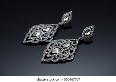 Luxury silver fashion earrings on black background