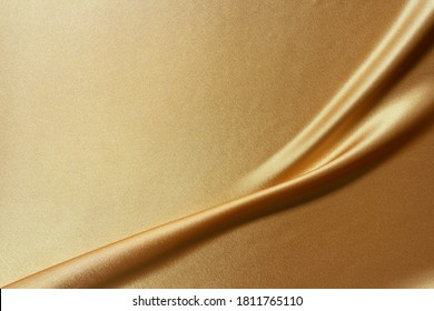 Luxury smooth elegant golden silk fabric texture as background Abstract background