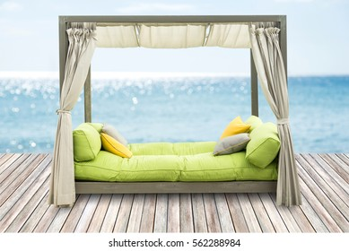 Luxury Sofa Bed with Soft Pillow as Interior Furniture with Blue Sea.