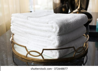 Luxury and soft Towel stacked in golden color tray