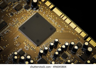 Luxury sound processor on motherboard close-up. Golden warm colors, selective focus