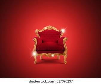Luxury sparkling golden armchair and red velvet