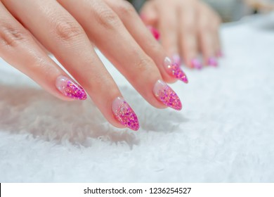 luxury sparkling pink purple glitter gel nail art ombre style on fashionista woman acrylic fingernail,girl doing spa manicure