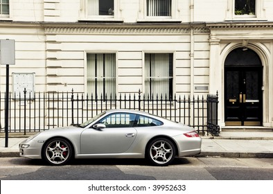 Luxury sport car in front of a house facade