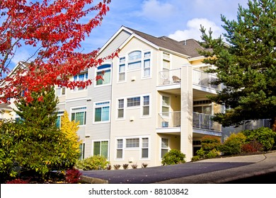 luxury suburban houses in sunny day with blue sky