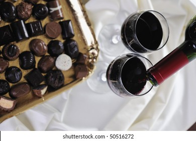 luxury and sweet praline and chocolate with wine bottle and glasses  decoration