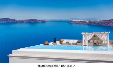 Luxury swimming pool facing the caldera, Santorini, Greece