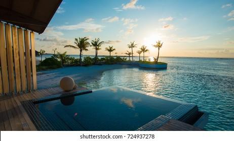Luxury swimming pool near beach front - Shutterstock ID 724937278