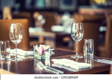Luxury table with glasses, napkins and cutlery in restaurant or hotel.