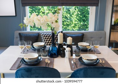 luxury table set on stone dining table in modern dining room, interior design concept