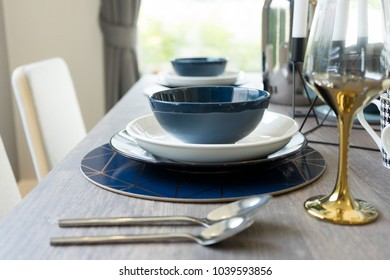 luxury table set on wooden dining table in modern dining room, interior design concept
