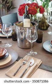 luxury table set on wooden dinning table with bottom of wine