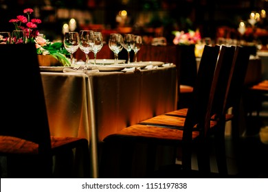 Luxury table settings for fine dining with and glassware, beautiful blurred  background. For events, weddings.  Preparation for holiday  Christmas and Hanukkah dinner night. props for weddings, birthd