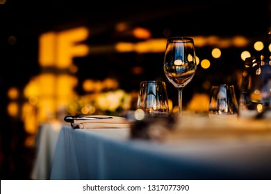 Luxury table settings for fine dining with and glassware, beautiful blurred  background. For events, weddings.  Preparation for holiday  passover, props for weddings, birthdays, and celebrations.