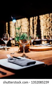 Luxury table settings for fine dining with and glassware, beautiful blurred  background. For events, weddings.  Christmas and Hanukkah dinner night. props for weddings, birthdays, and celebrations.