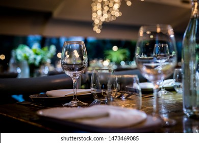 Luxury table settings for fine dining with and glassware, beautiful blurred  background. For events, weddings.  Preparation for holiday   props for weddings, birthdays, and celebrations.