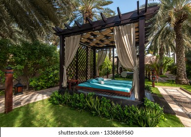 Luxury tents canopies in  tropical park under palm trees