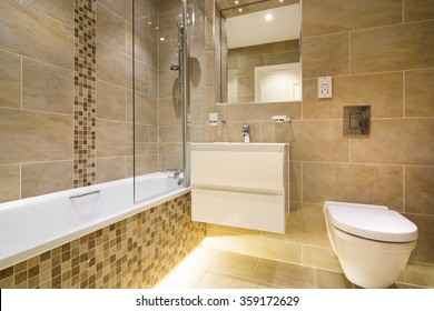 Luxury three piece bathroom in beige - brown with mosaic and natural stone tiles