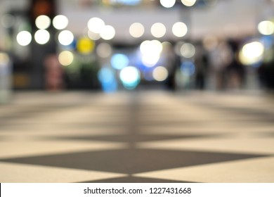 Luxury tiles pathway and the lights bokeh at the far end blur blackground